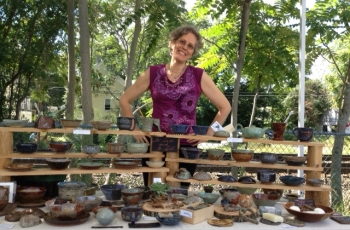 pottery on sale by Debra Griffin and demos by student Tonya at Ashland Farmers Market, Ashland MA