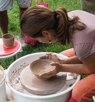 pottery demo by debra griffin's student at the ashland farmers market in Ashland, MA