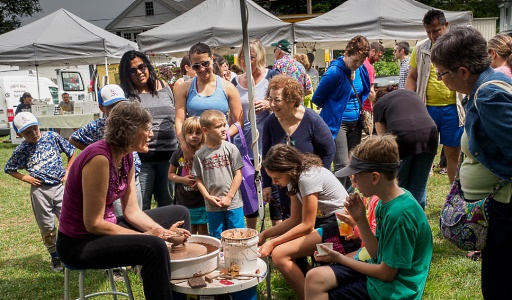 debra griffin demoing pottery at the ashland farmers market in Ashland, Massachusetts